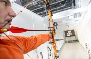 archer shooting a compound bow