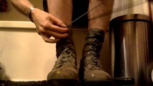 lacing up a tactical boot