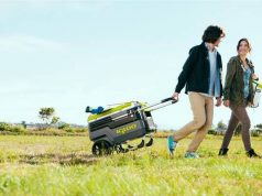 man dragging wheeled cooler on the plain