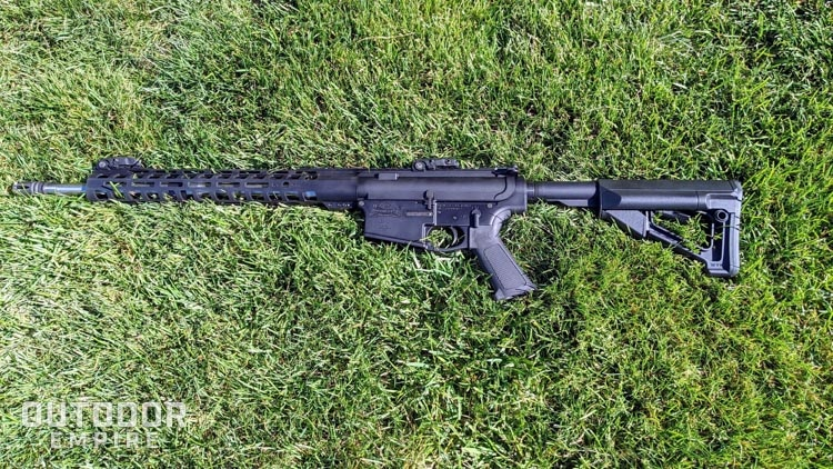 AR-10 laying on grass with left side up